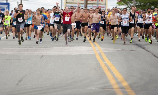 Runners make their way to Bangor at the start of the 34th annual Walter Hunt Memorial Fourth of July 3K road race Friday. The race starts in Brewer and travels into Bangor.