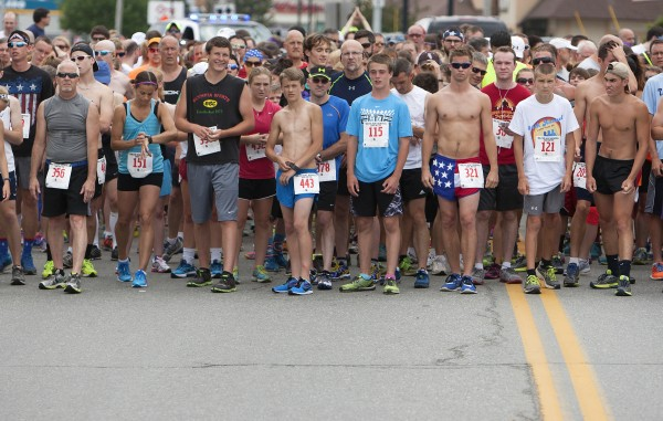Runners take their mark before the start of the 34th annual Walter Hunt Memorial Fourth of July 3K road race Friday. The race starts in Brewer and travels into Bangor.
