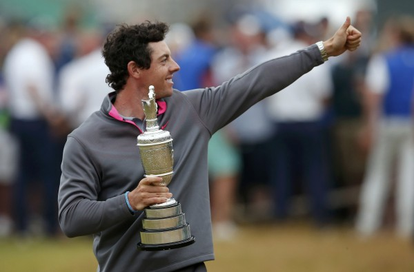 Rory McIlroy of Northern Ireland celebrates as he holds the Claret Jug after winning the British Open Championship at the Royal Liverpool Golf Club in Hoylake, England, Sunday.