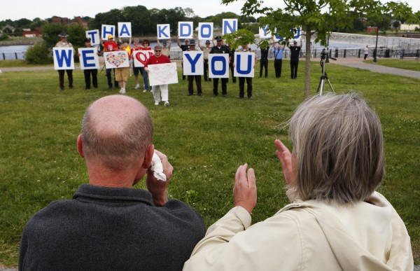 Don Winslow (left) wipes a tear from his eyes after watching a flash mob in his honor with wife, Dora Winslow, on Tuesday, June 17, at the Bangor Waterfront.