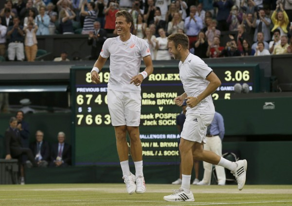 Vasek Pospisil of Canada and Jack Sock (right) of the U.S. celebrate their victory over Bob Bryan and Mike Bryan of the U.S. in their men's doubles final tennis match at the Wimbledon Tennis Championships in London on Saturday.