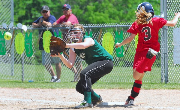 Scarborough's Bella Dickinson (3) beats the throw to Shaker Valley first baseman Emily Davison (3) on an infield hit in the fifth inning of action at the State Little League Softball Tourney for ages 11-12 at Hermon Little League Field on Saturday.