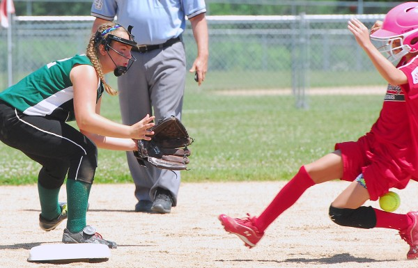 The throw to Shaker Valley Hannah Collins (22) hits Scarborough's Lauren Wagner (1) as she steals second base in the fifth inning during the State Little League Softball Tourney for ages 11-12 at Hermon Little League Field on Saturday.