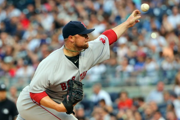 Boston's Jon Lester delivers a pitch during the first inning against the New York Yankees at Yankee Stadium on June 28.