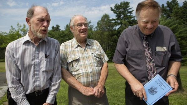 Constitution Coalition spokespersons (from left) Jack McCarthy, Wayne Leach and Phil Merletti speak with the media before conducting a seminar at the Hampden municipal building Saturday.