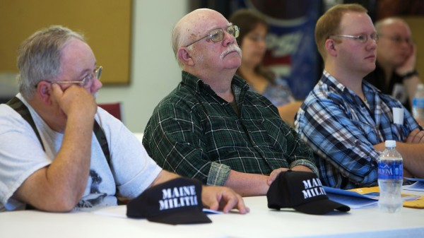 Al Giles (from left), Mack C. Page, and Mack Page listen to presenters at the Constitution Coalition of Maine seminar Saturday in Hampden.