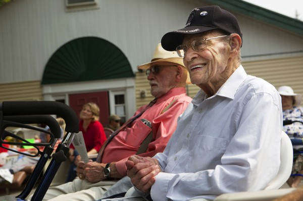 Henry F. Watson (right) smiles while listening to a special concert from the Bangor Band to honor him Saturday at the Courtland Rehabilitation and Living Center in Ellsworth.