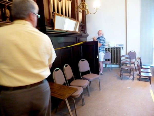Bill Heenehan (left) and organ maker A. David Moore on June 16 measure the space where a new organ console will be placed at Hammond Street Congregational Church in Bangor. A restored pipe organ is expected to be installed in May 2015.