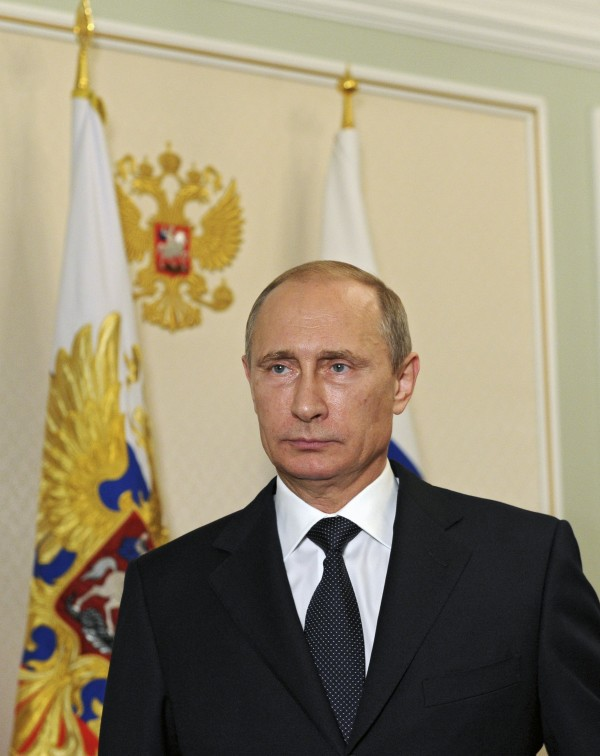 Russian President Vladimir Putin makes a televised statement at the Novo-Ogaryovo state residence outside Moscow, in the early hours of July 21, 2014. Putin said Monday the downing of Malaysia Airlines Flight MH17 in east Ukraine must not be used for political ends and urged separatists to allow international experts access to the crash site.