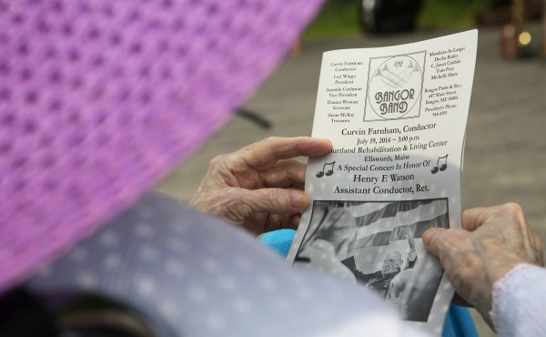 A music listener looks over a program for the special concert to honor Henry F. Watson on Saturday at the Courtland Rehabilitation and Living Center in Ellsworth.