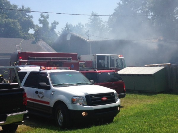A fire burns auto repair shop R.P. Bell Collision in Saco on Monday afternoon.