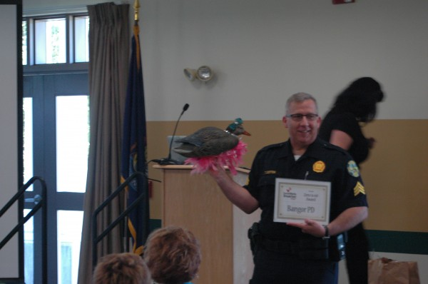 Bangor police Sgt. Tim Cotton accepts the &quot0-60 award&quot for the rapid rise in popularity of the Bangor Police Department's Facebook page during the annual Social Media Bangor breakfast Thursday at Husson University.