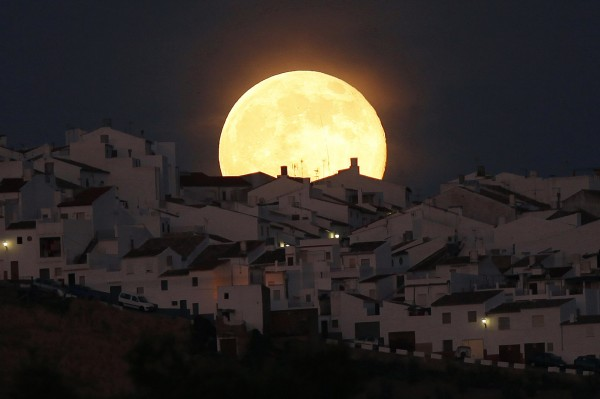 The supermoon rises over houses in Olvera, in the southern Spanish province of Cadiz, on Saturday.