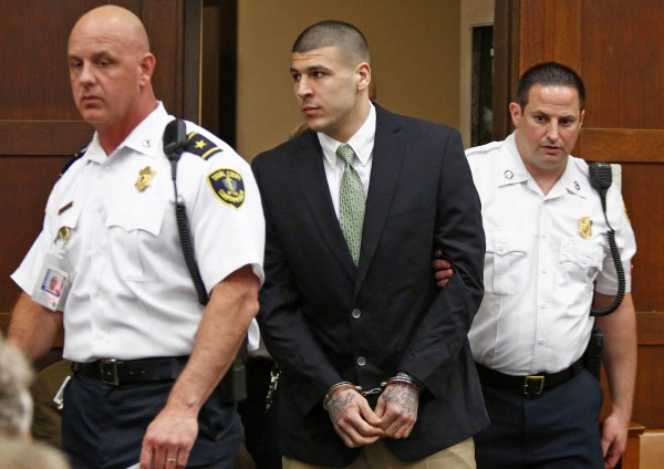 Former NFL player Aaron Hernandez enters the courtroom to be arraigned on homicide charges at Suffolk Superior Court in Boston, Massachusetts in this file photo taken May 28.