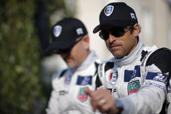 U.S. actor Patrick Dempsey gestures during a parade on the eve of the 82th 24-hours Le Mans endurance race in Le Mans, June 13, 2014.