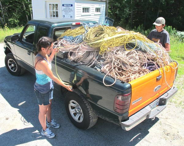 Michelle Kinerson of Cape Porpoise Trading Co. in Kennebunkport and Joseph Look of Ellsworth tie down old fishing rope in the back of Kinerson's pickup on Friday at Coastal Recycling Center in Hancock.