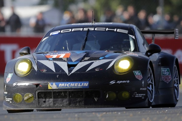 U.S. actor Patrick Dempsey drives his Porsche 911 RSR number 77 during the Le Mans 24-hour sportscar race in Le Mans, central France June 14, 2014.