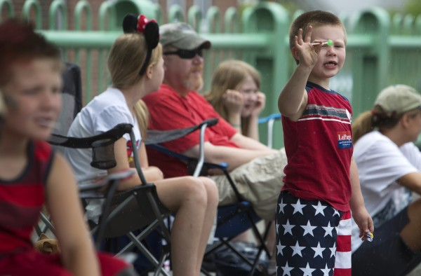 Seth Malcolm, 4, waves to people in the parade.