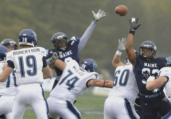 Maine defensive end Trevor Bates (92) tries to get a hand on a pass from Villanova quarterback John Robertson (19) during their game Sept. 29, 2012 in Orono. The CAA has named Bates a preseason All-Conference selection.