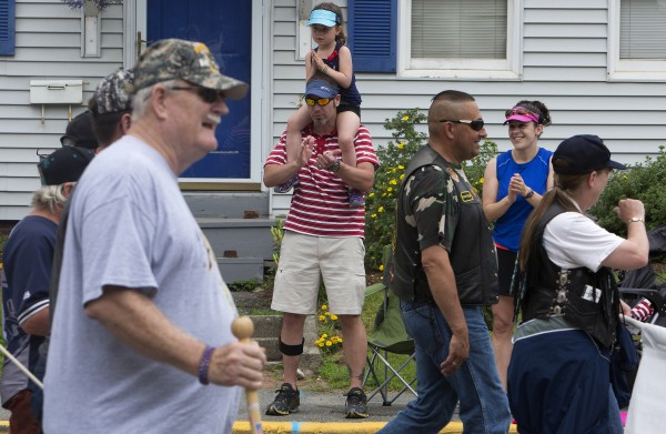 Preya Hammer, 4, claps in appreciation of local veterans with her father, David Hammer, and mother, Nicole Hammer, during the annual Fourth of July parade Friday.