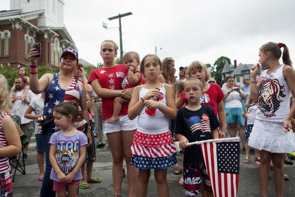 People of all ages dressed in patriotic garb to watch the annual Fourth of July parade.