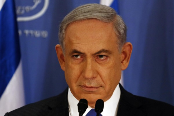 Israeli Prime Minister Benjamin Netanyahu pauses as he speaks during a news conference on Friday at the defense ministry in the Israeli coastal city of Tel Aviv.