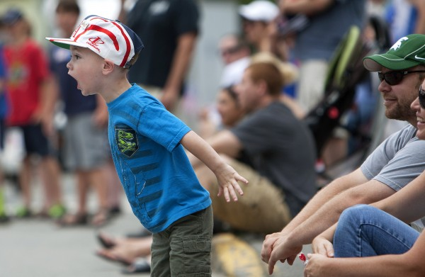 Tyrus Baxter, 3, yells in amazement during the annual Fourth of July parade.