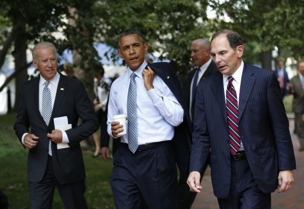 U.S. President Barack Obama walks across Lafayette Park back to the White House on June 30, 2014.