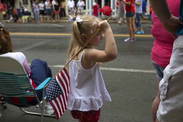 Hannah Doucette, 4, watches the annual Fourth of July parade.