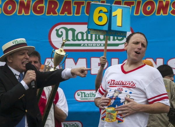 Former Bangor resident George Shea, CEO of Major League Eating, points to men's division winner Joey Chestnut, who was celebrating his win after the annual Nathan's Famous Fourth of July Hot Dog Eating Contest at Coney Island in Brooklyn.