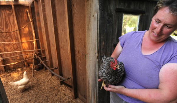 Rose Rapp the owner of Farmetta Farm in Morrill holds one of her chickens