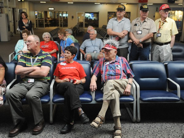 Members of the Maine Troop Greeters look on during a ceremony at the Bangor International Airport Wednesday.