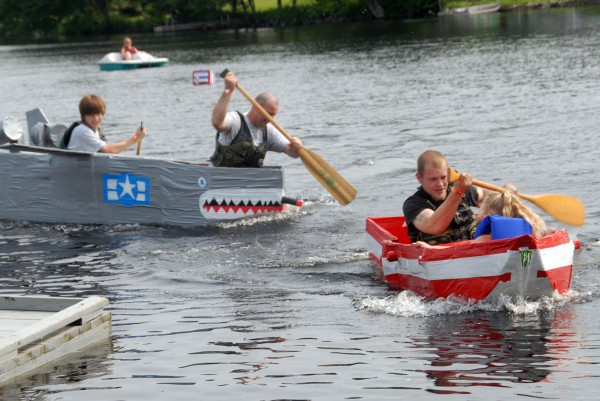 Eleven watercraft made of cardboard and duct tape raced in the 2014 Lincoln Homecoming's &quotRedneck Regatta&quot on Saturday, July 19, 2014.