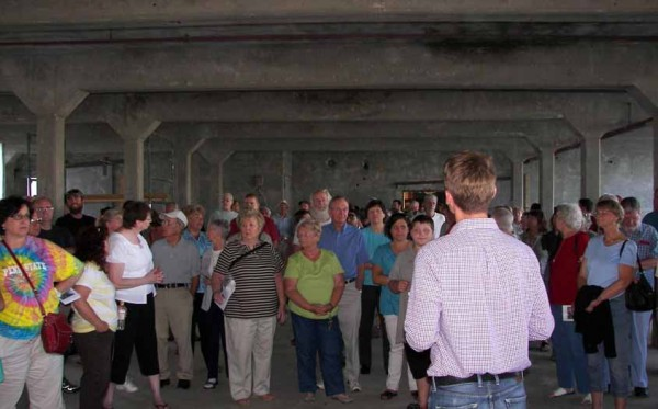 Jonathan Arnold of the Arnold Development Group leads a tour of the Riverfront Redevelopment Project on July 21 in downtown Dover-Foxcroft.