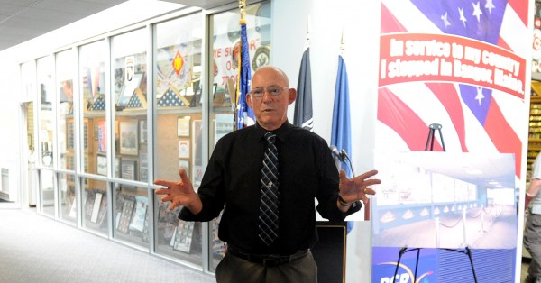Charles Knowlen, chairman of the Maine Troop Greeters, speaks during a ceremony at the Bangor International Airport Wednesday.  The group received a $15,000 donation from Bangor Savings Bank.