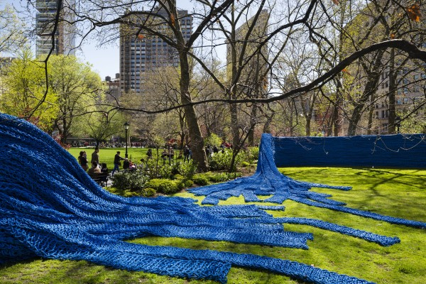Visitors walk past a blue section of Orly Genger's &quotRed, Yellow and Blue,&quot which was fashioned from old rope that had been used by Maine lobstermen, in Madison Square Park in New York City in the spring of 2013.