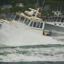 Whistler, entered by Isaac Dworsky, races against Chris Page's Abigail and Carter during the 2014 lobster boat races on Sunday in Stonington.