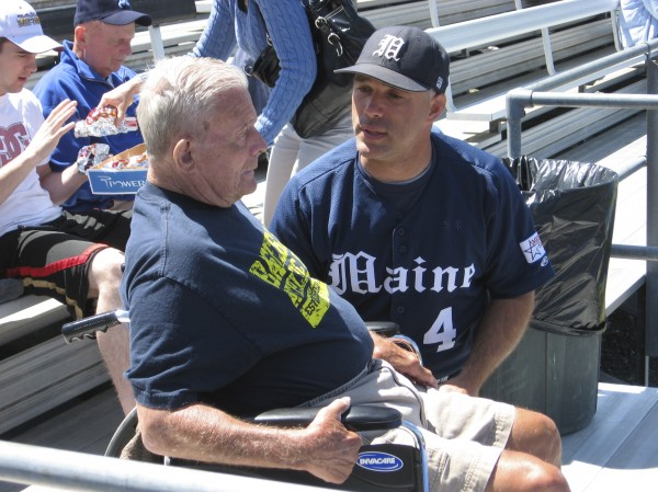 Former University of Maine baseball coach John Winkin (left) chats with Black Bears coach Steve Trimper prior to an America East game against Albany on May 16, 2010 at Mahaney Diamond in Orono. Winkin died Saturday at age 94.