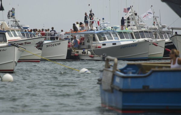 Spectators tie off to moorings, each other or anchor in Stonington Harbor along the &quottrack&quot where lobster boats faced off during the 2014 lobster boat races on Sunday in Stonington.