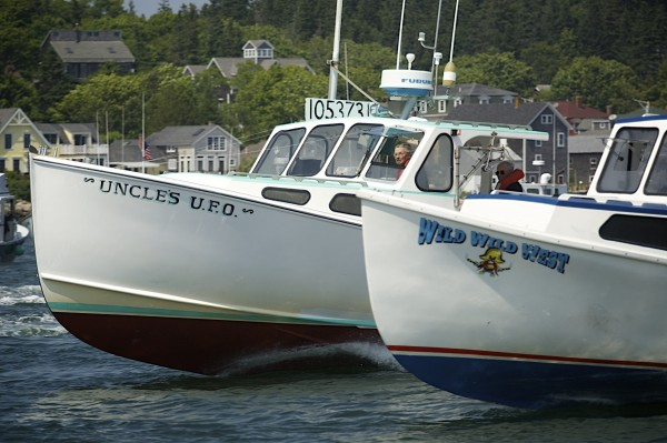&quotUncle's U.F.O.&quot, owned by Andy Gove, and Cameron Crawford's &quotWild Wild West&quot race during the 2014 lobster boat races on Sunday in Stonington.