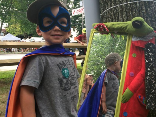 Yarmouth resident Tristan Goggin channels his inner superhero at the Creative Capes booth in the craft show section of the 49th annual Yarmouth Clam Festival.