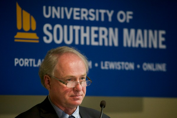 University of Maine System Chancellor James Paige introduces David Flanagan, the retired CEO of Central Maine Power Co. and new interim president at the troubled University of Southern Maine, at a press conference on Wednesday in Portland.