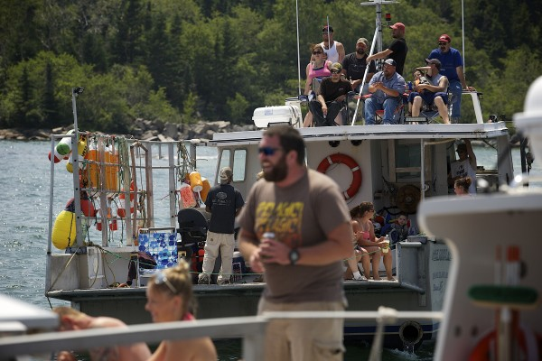 Spectators cheer as lobster boats face off in drag races during the 2014 lobster boat races on Sunday in Stonington.