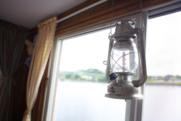 A decorative lamp hangs from Guy Armstrong's houseboat he keeps docked on the Bangor Waterfront throughout the summer months.