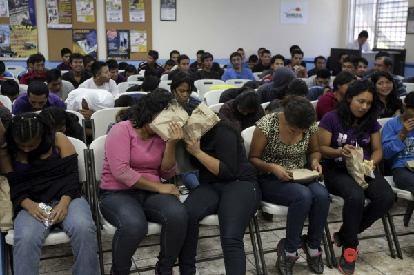 Illegal migrants from Guatemala who have been deported from the U.S. wait to provide their particulars to the immigration authorities after arriving at La Aurora airport in Guatemala City, July 10, 2014.