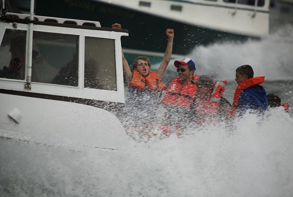 Racers cheer as they cross the finish line during the 2014 lobster boat races on Sunday in Stonington.