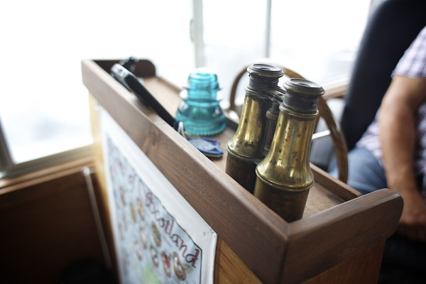 A pair of binoculars rests at the helm of Guy Armstrong's houseboat he keeps docked on the Bangor Waterfront throughout the summer months.
