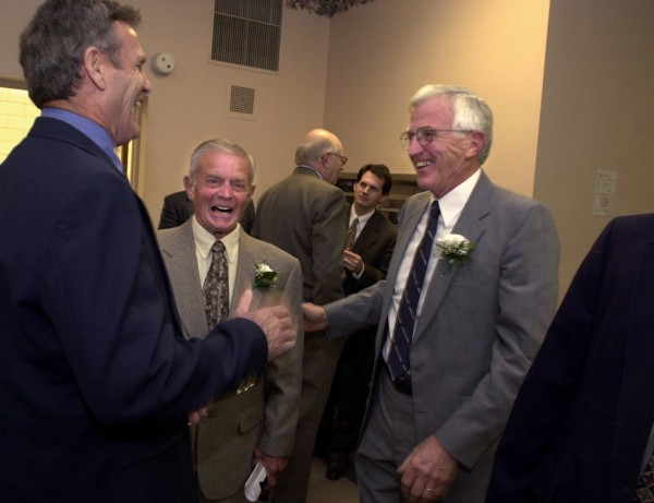 University of Maine Sports Hall of Fame inductees (from left) Alan Switzer, John Winkin and Woody Carville share laughs at the Wells Conference Center in Orono on Oct. 21, 2001.