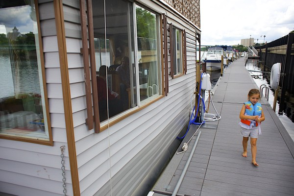 Lily Wilcox, 5, walks to the front of her grandfather, Guy Armstrong's, houseboat he keeps docked on the Bangor Waterfront throughout the summer months.