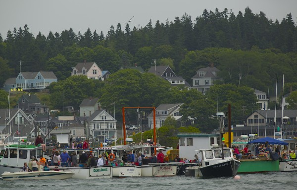 Spectators watch lobster boats face off during the 2014 lobster boat races on Sunday in Stonington.